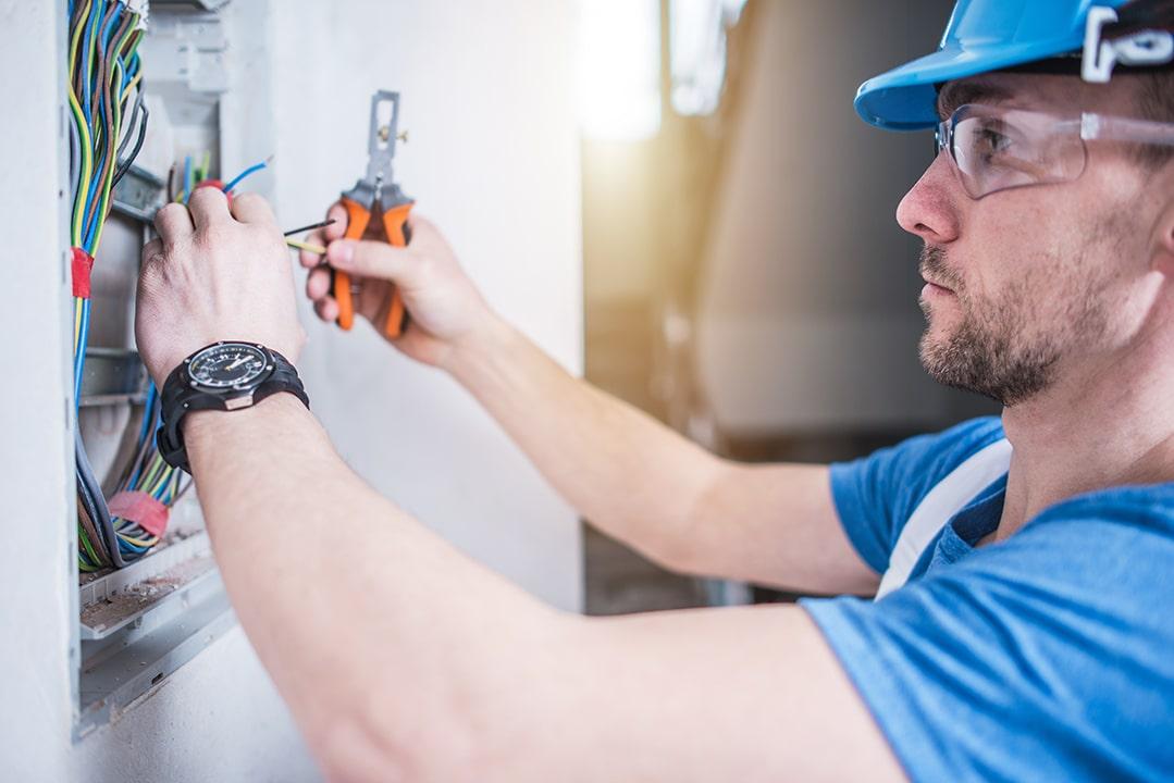 Electric Technician Job. Electrician Finishing Electric Box Inside the Apartment.